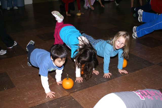 kids working out with a pumpkin columbus bootcamp